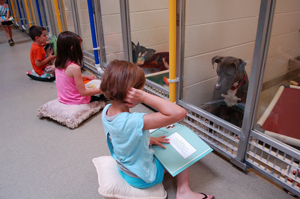 Children Reading to Dogs web